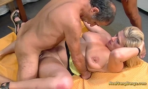 Busty extraordinary pierced milf receives biggest gangbanged